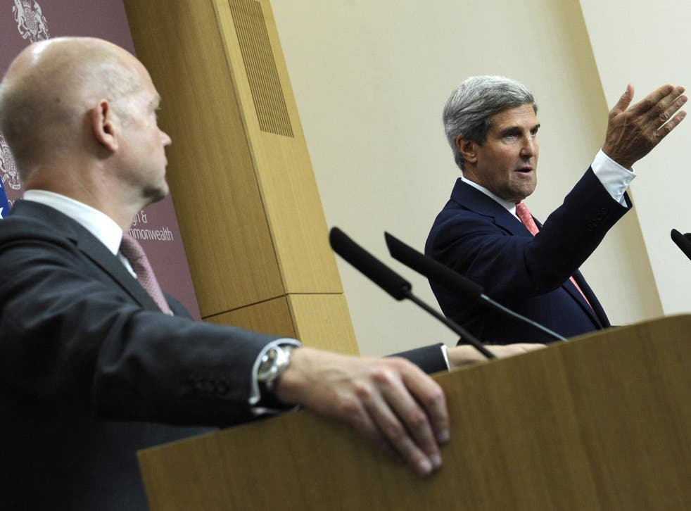 US Secretary of State John Kerry, right, speaks as Britain's Foreign Minister William Hague, left, listens during a news conference at the Foreign and Commonwealth Office in London