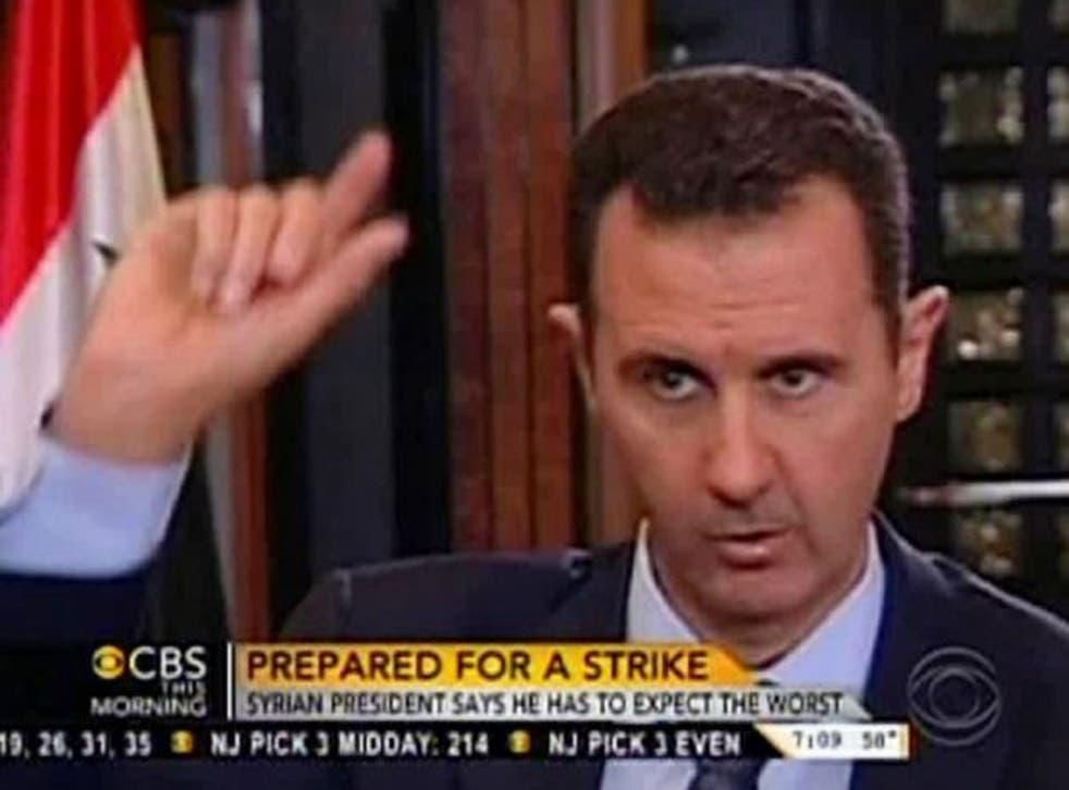 """In this frame grab from video provided by CBS This Morning, Syrian President Bashar al-Assad warns there will be """"repercussions"""" for the US if it launches a military strike. Assad said, """"You should expect everything."""""""