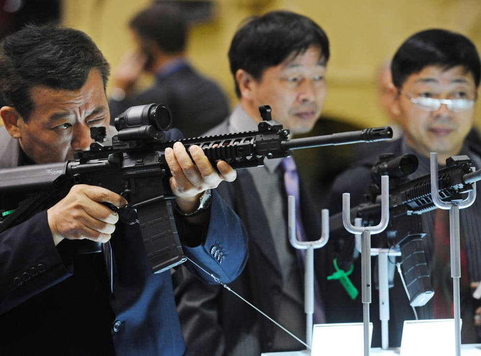 Customers at the Defence and Security Equipment International (DSEI) arms fair in east London