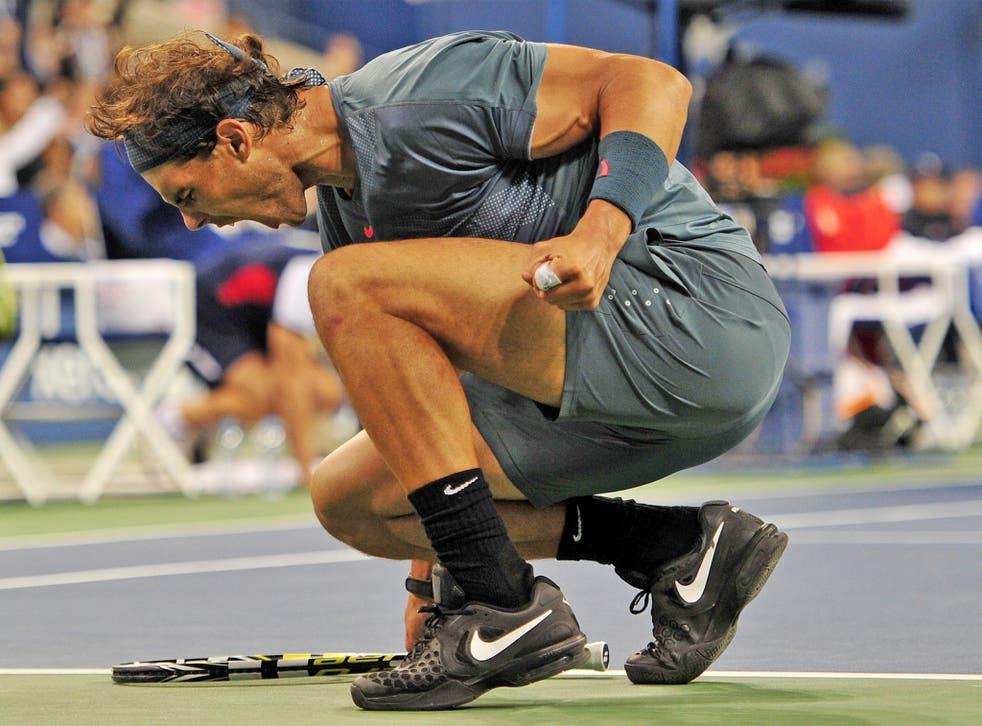 Rafael Nadal celebrates winning his 13th Grand Slam