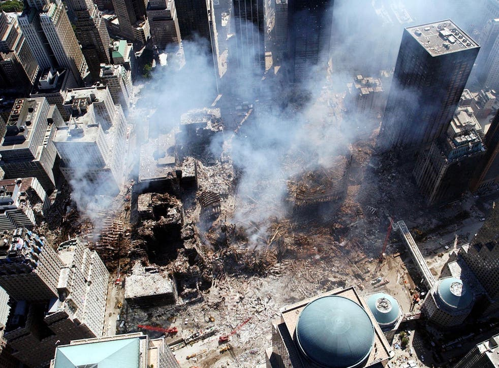 September 2001: An aerial view shows only a small portion of the crime scene where the World Trade Center collapsed following the September 11, 2001 terrorist attack in New York City. Surrounding buildings were heavily damaged by the debris and massive fo
