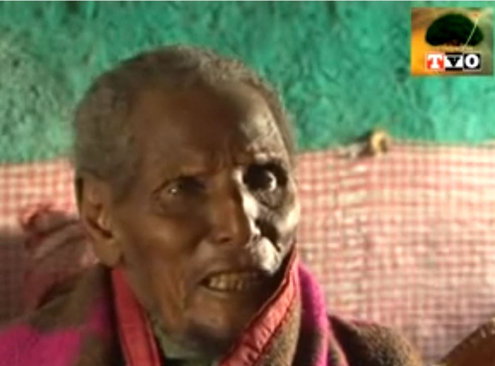 Dhaqabo Ebba, pictured here telling TV reporters his memories of events in the 19th Century, could be the oldest man ever to have lived at 160 years old