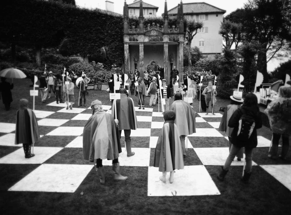 Festival-goers play on the human chess board from the cult TV series The Prisoner