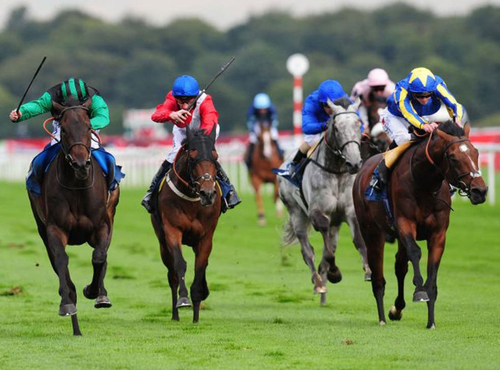 Times Up, left, ridden by Ryan Moore, wins the Speedy Services Doncaster Cup, at Doncaster yesterday