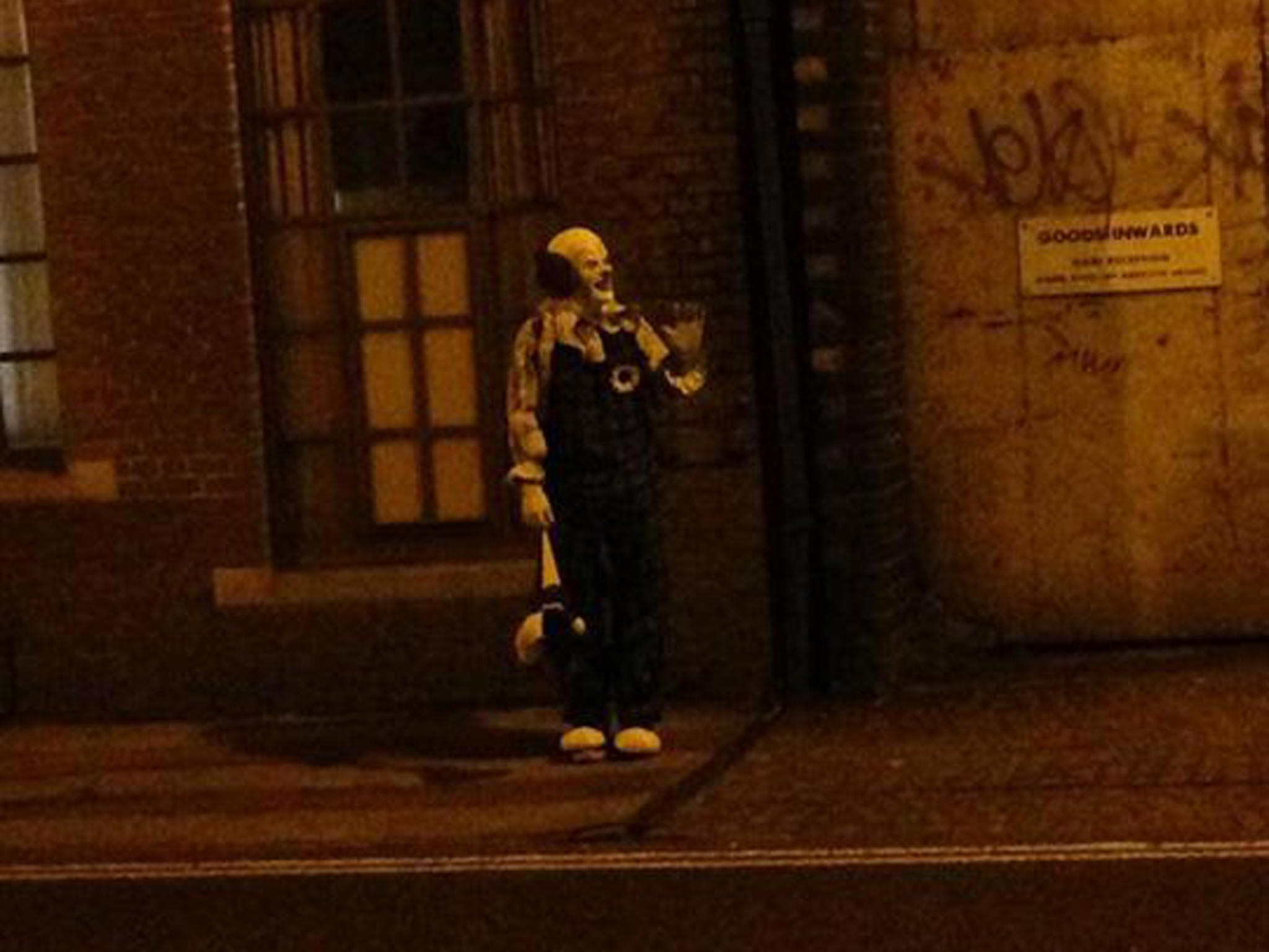 'He doesn't juggle. He doesn't twist balloons into animal shapes. He just stares': Who is the creepy clown terrifying the people of Northampton?