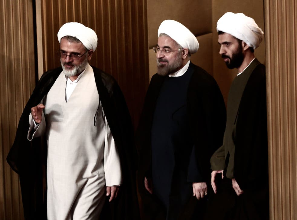 Iranian President Hassan Rouhani (C) attends a session of the Assembly of Experts in Tehran on September 3, 2013.