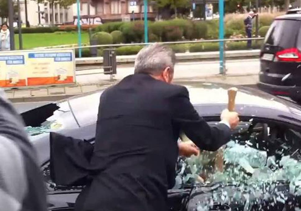 Businessman smashes up his £100,000 BMW with an axe as a protest ...