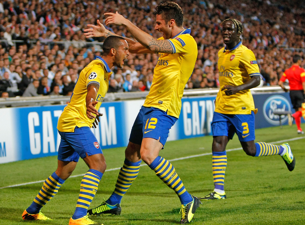 Theo Walcott is joined by his teammates to celebrate the opening goal