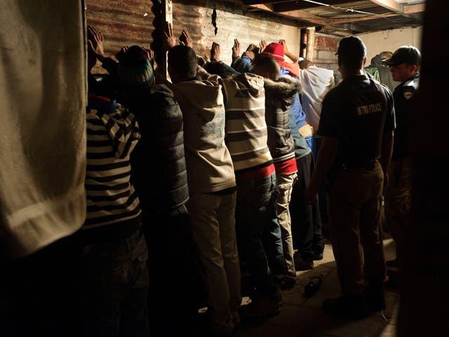 A group of men are arrested in a gambling den in Manenburg