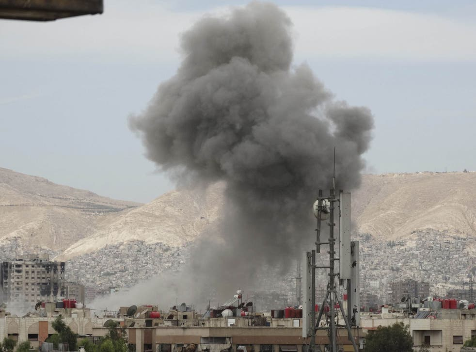 Missile strikes in Damascus are ignored by the city's middle classes who 'pretend that the war is not happening'