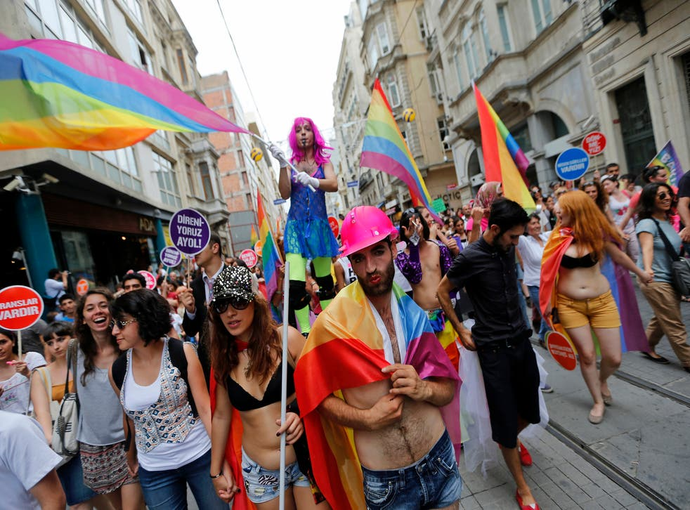 People march during a gay pride parade in central Istanbul June 30, 2013. Tens of thousands of anti-government protesters teamed up with a planned gay pride march in Istanbul.