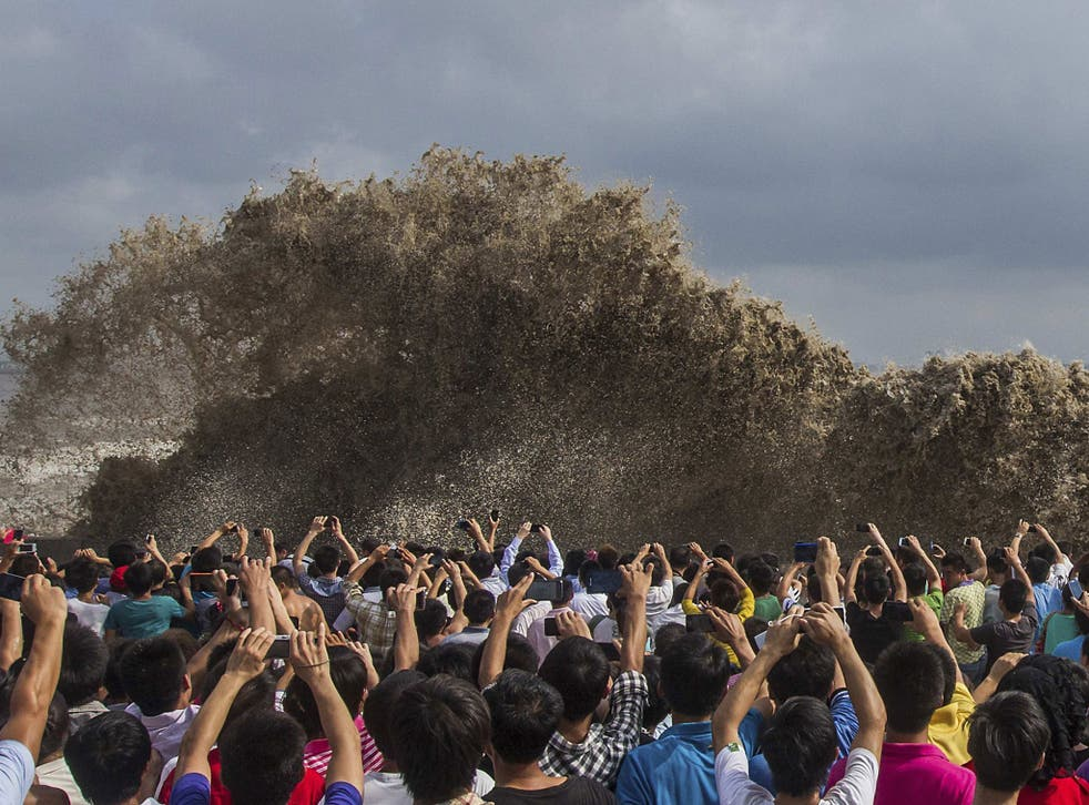In Hangzhou, just south of Shanghai, the typhoon brought huge tidal waves on the Qiantang river