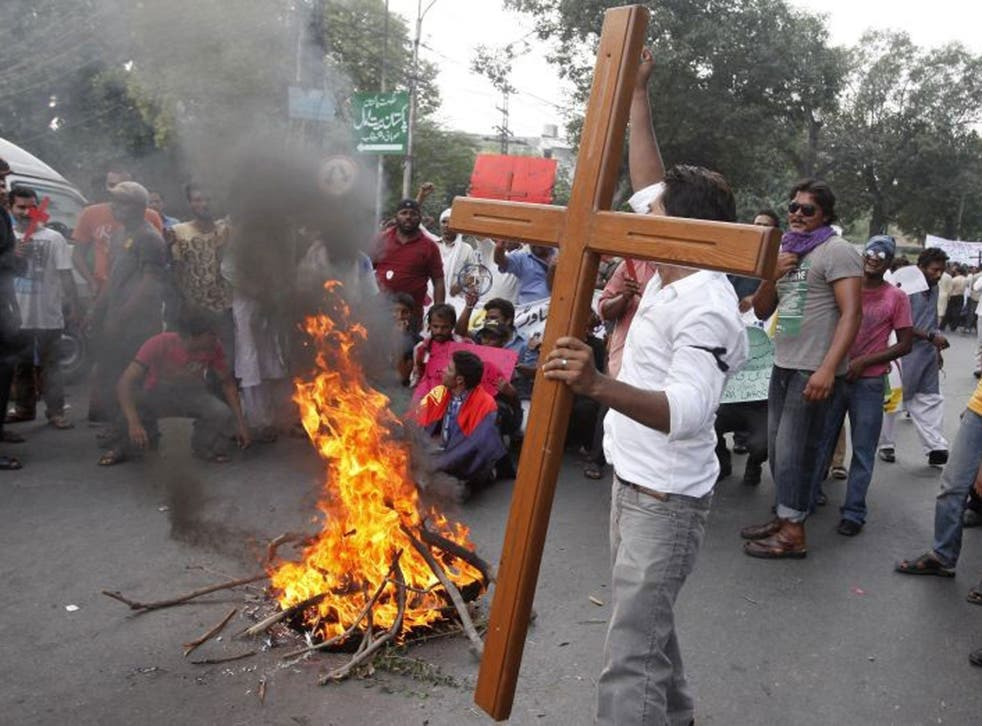 Pakistani Christians at a protest rally to condemn Sunday's suicide attack