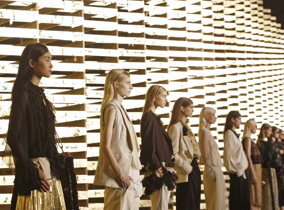 Models wear creations for Belgian fashion house Dries van Noten's ready-to-wear Spring/Summer 2014 collection