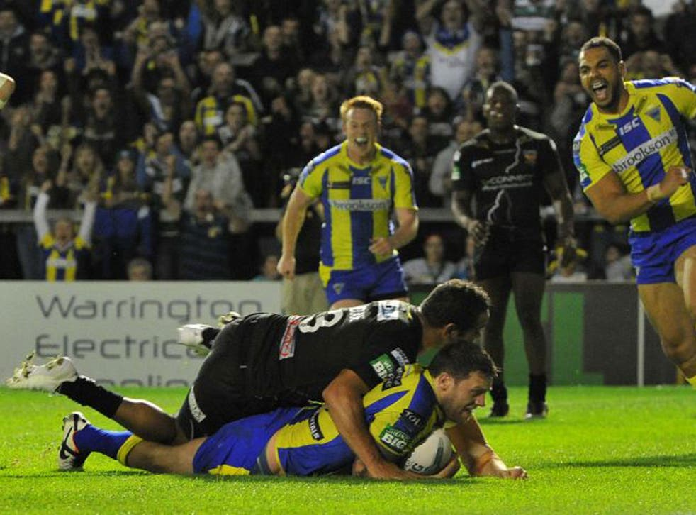 Simon Grix goes over for his first and Warrington's third try