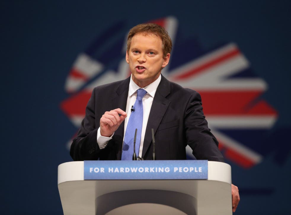 Conservative party Co-Chairman Grant Shapps delivers his speech in the main hall on the first day of the Conservative Party Conference