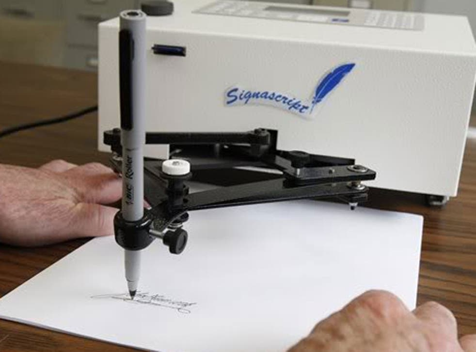 An mechanical signing machine (note: nothing to do with Apple)