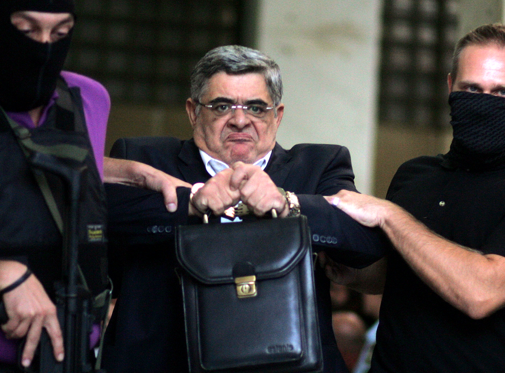 Golden Dawn leader Nikos Michaloliakos, during his arrest in September 2013