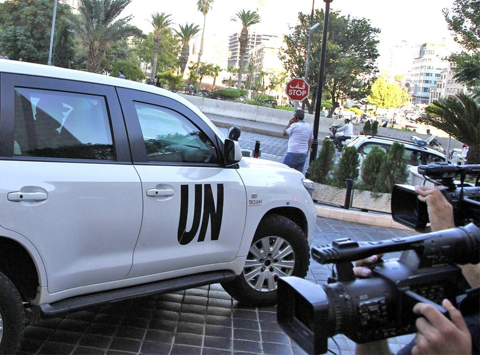 A UN vehicle transporting a team of weapons inspectors arrives at a hotel in Damascus