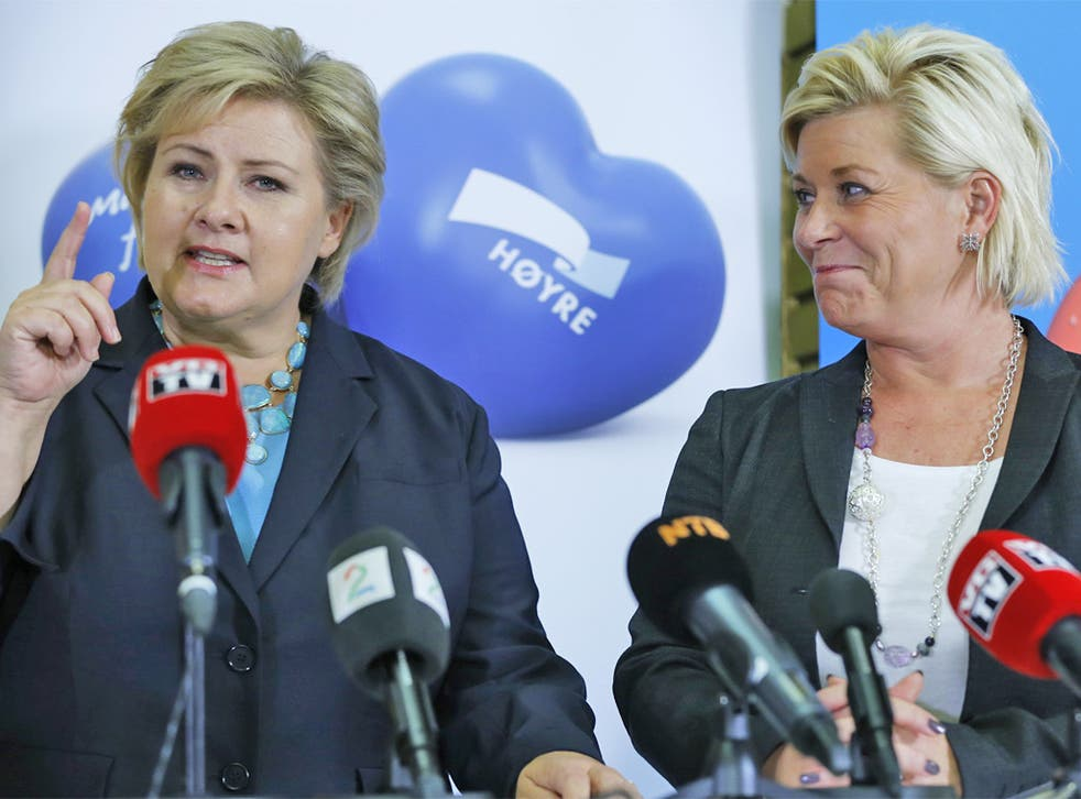 Erna Solberg (left), leader of the Conservative Party, and Progress Party leader Siv Jensen after signing the coalition agreement