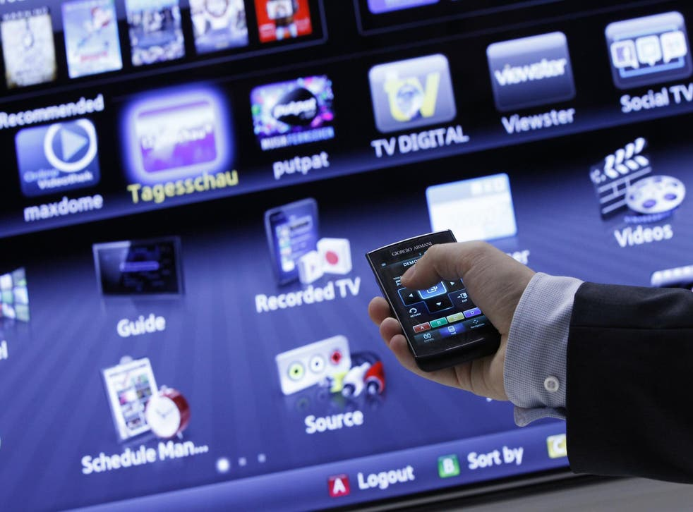 An exhibitor demonstrates a Samsung Smart TV at the IFA consumer electronics fair in Berlin, August 31, 2011.