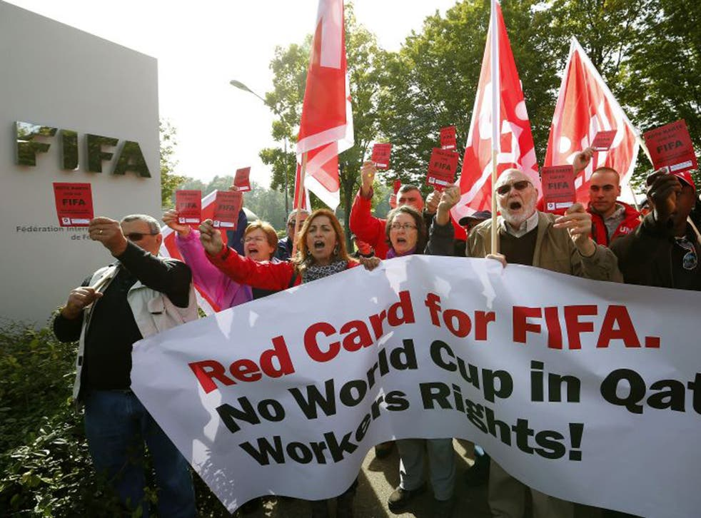 Members of Swiss workers' union Unia protest outside Fifa headquarters in Zurich.