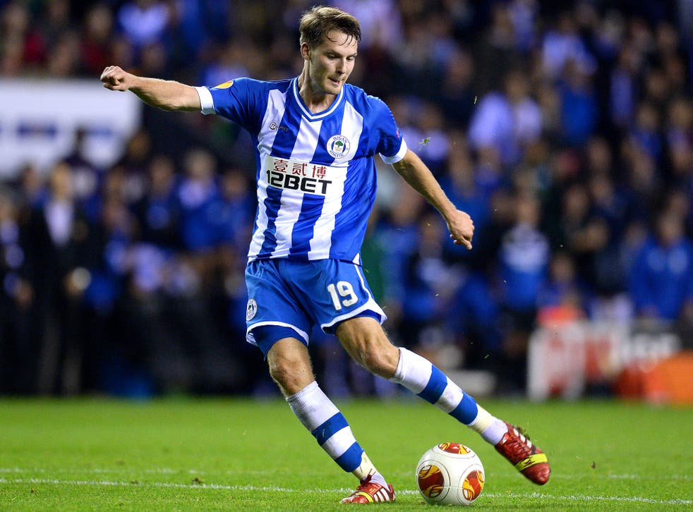 Nick Powell, on-loan from Manchester United, scored twice for Wigan in their 3-1 victory over NK Maribor