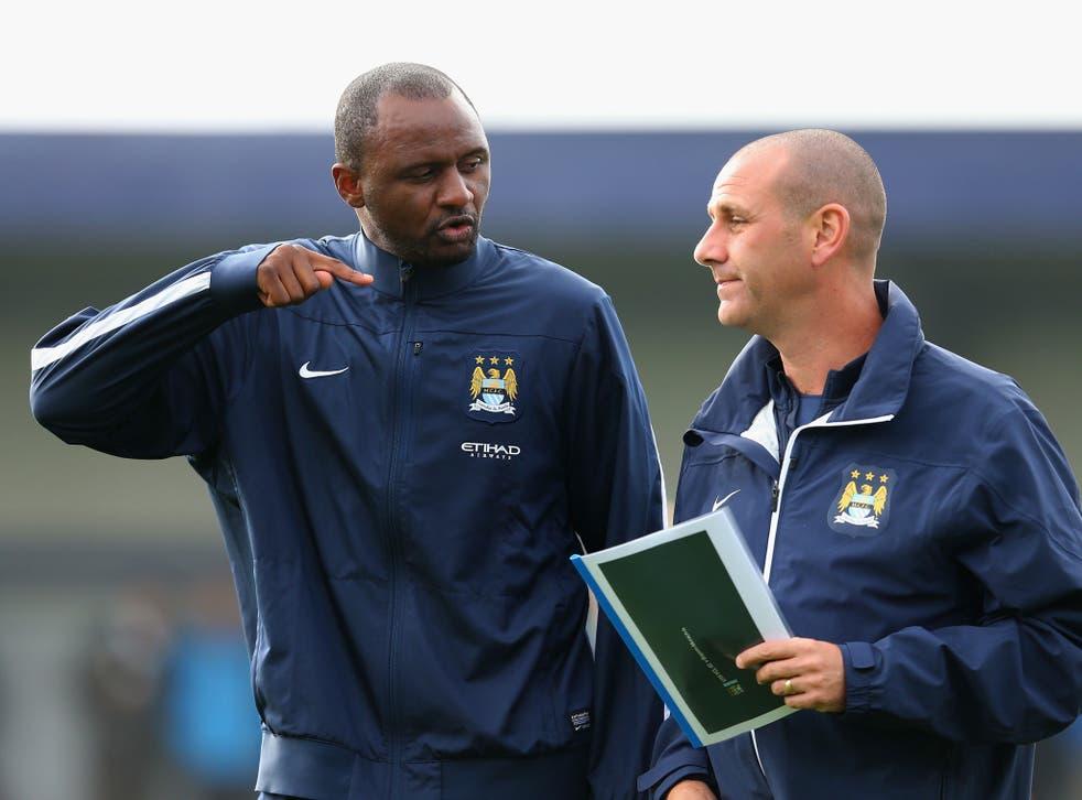 Patrick Vieira (left) talks tactics with assistant coach Simon Davies