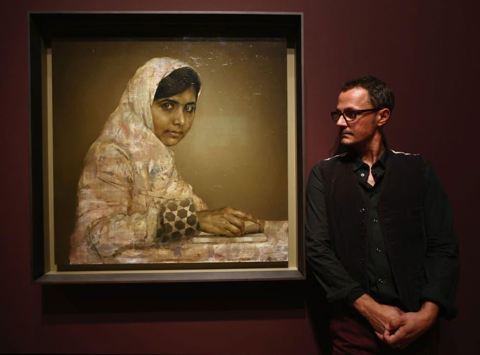 Jonathan Yeo with his portrait of Malala Yousafzai