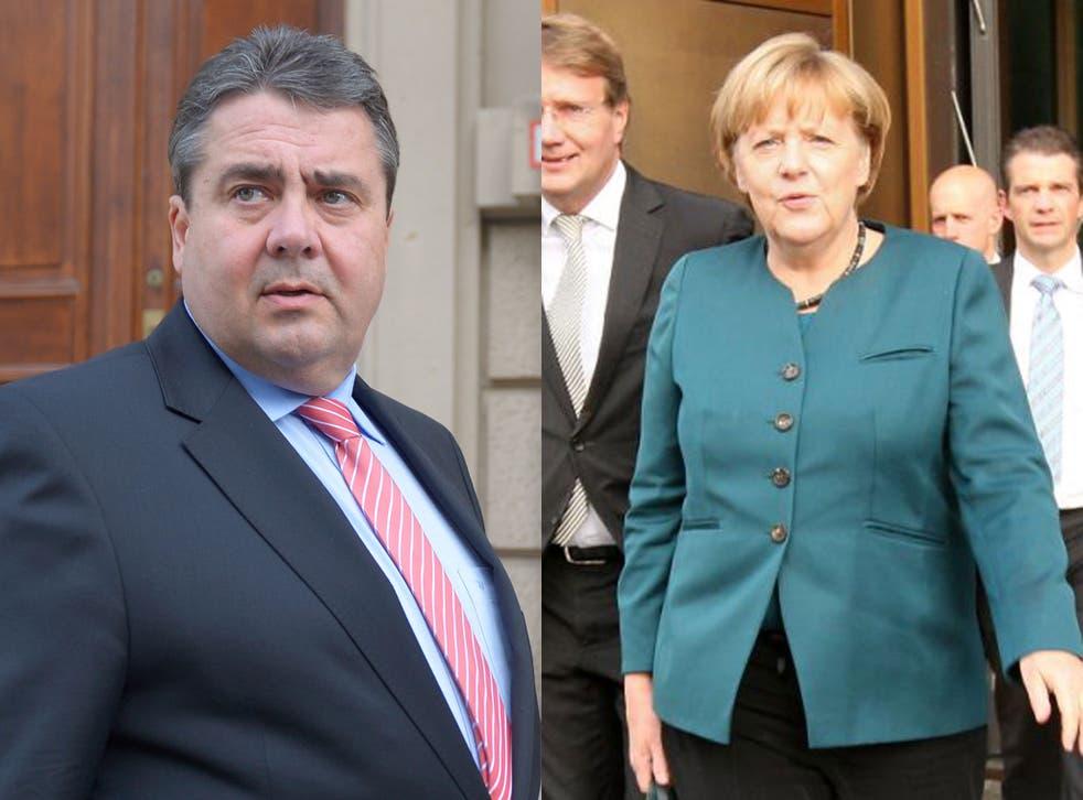 Social Democrat (SPD) leader Sigmar Gabriel, right, and German Chancellor Angela Merkel