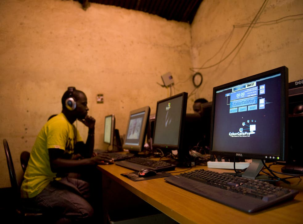A young man sits at a cyber cafe as he surfs the internet June 20, 2012 in Kibera slum in Nairobi.