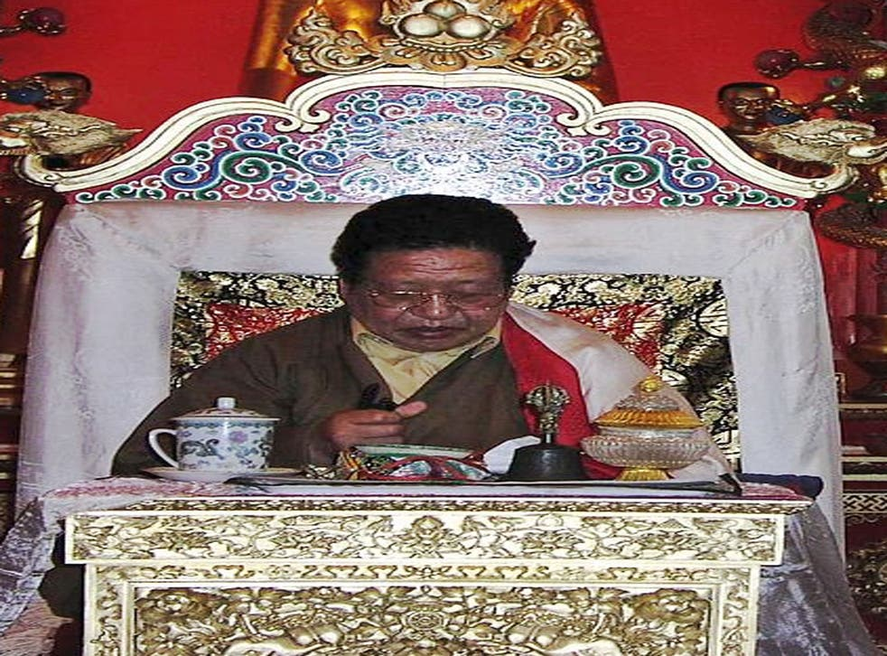 Akong Rinpoche on a throne at Samye Ling. The British Tibetan monk has been assassinated in China, according to police.