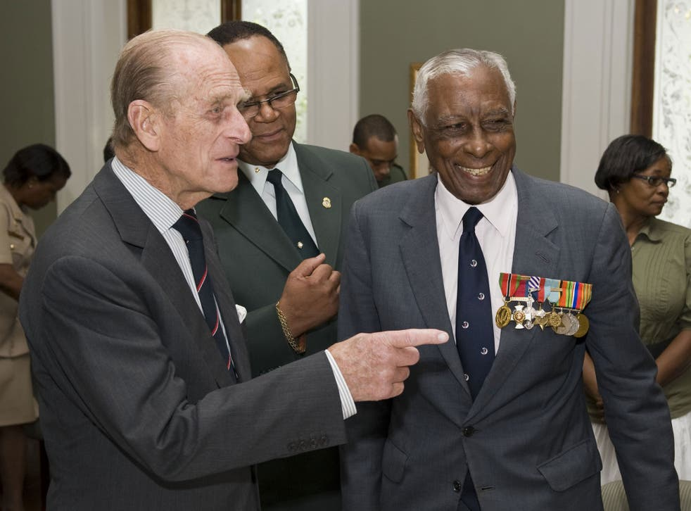 A bemedalled Cross with Prince Philip during a Royal visit to Trinidad and Tobago in 2009