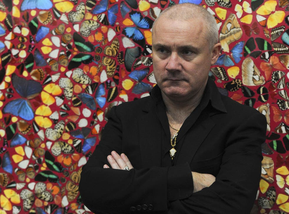 Damien Hirst stands in front of his artwork, 'I Am Become Death, Shatterer of Worlds 2006'