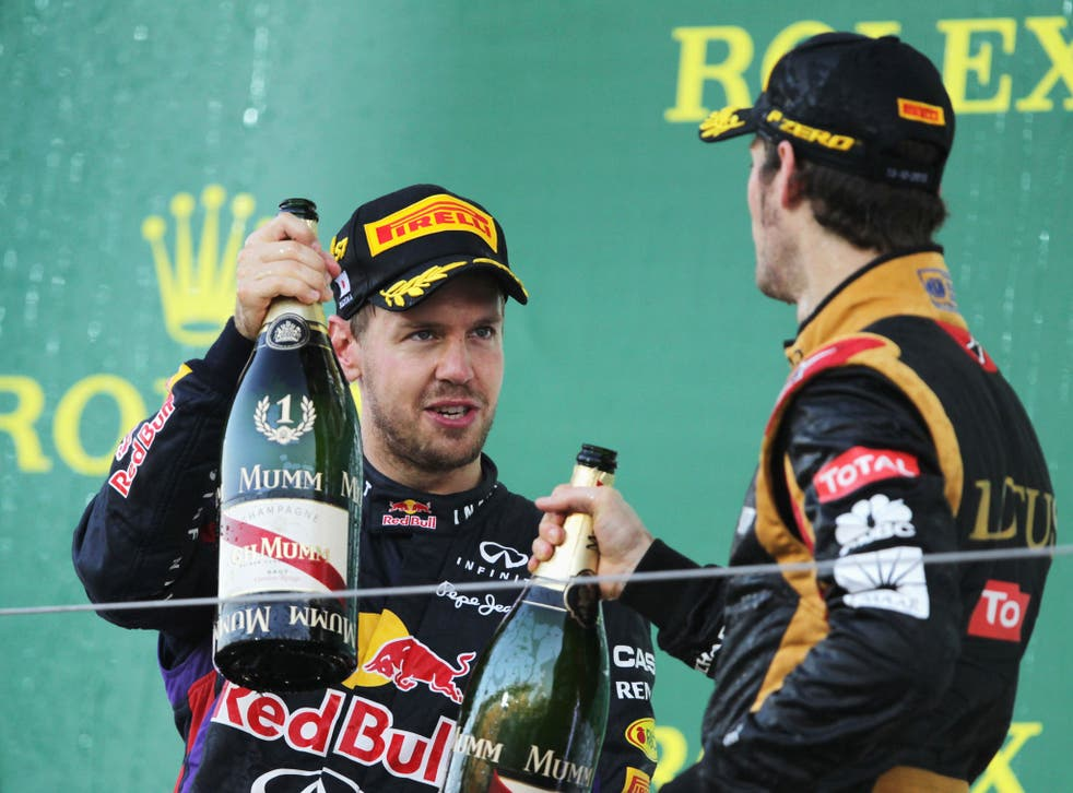 Sebastian Vettel celebrates his Japanese Grand Prix victory in which he passed Romain Grosjean for the win