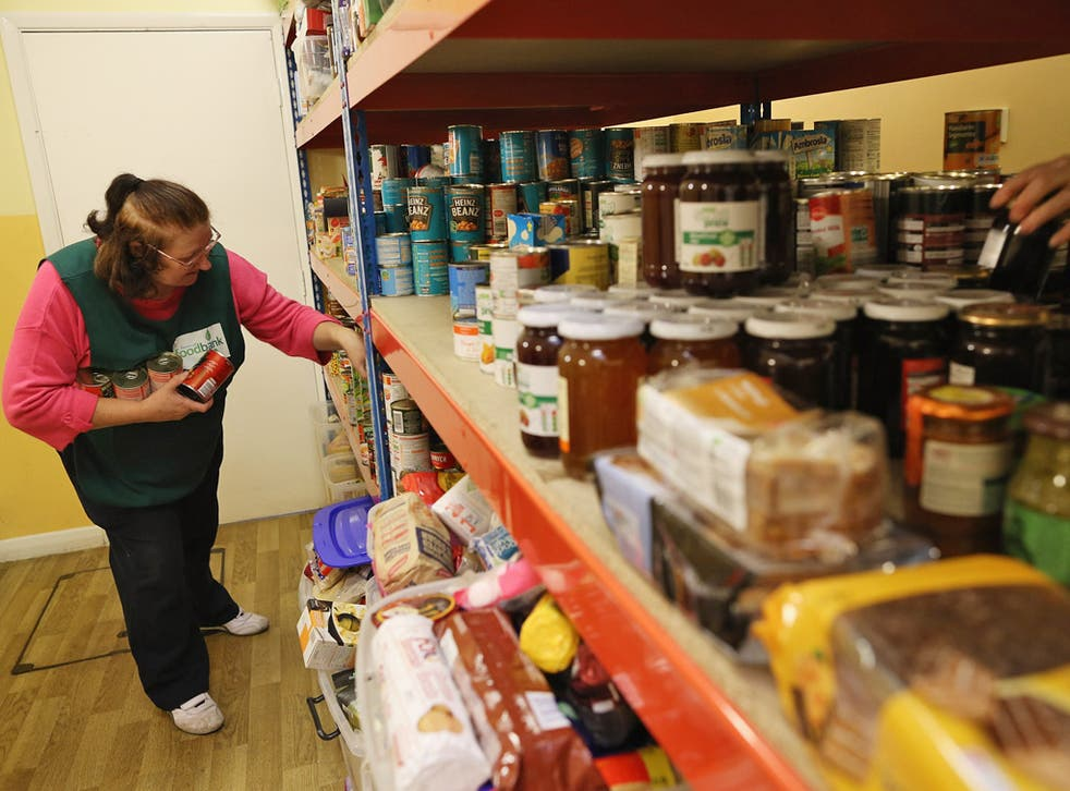 A volunteer puts together a parcel of food at a Food Bank in Brixton, south London