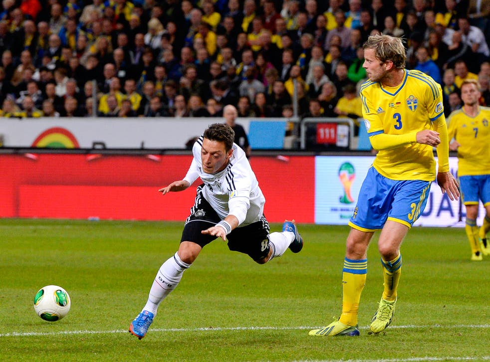 Mesut Ozil picked up a knee injury during Germany's 5-3 victory over Sweden