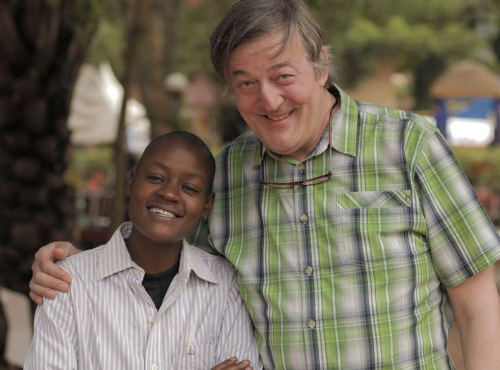 Sympathy for the devils: Stephen Fry with Stosh, a victim of 'corrective rape' in Uganda
