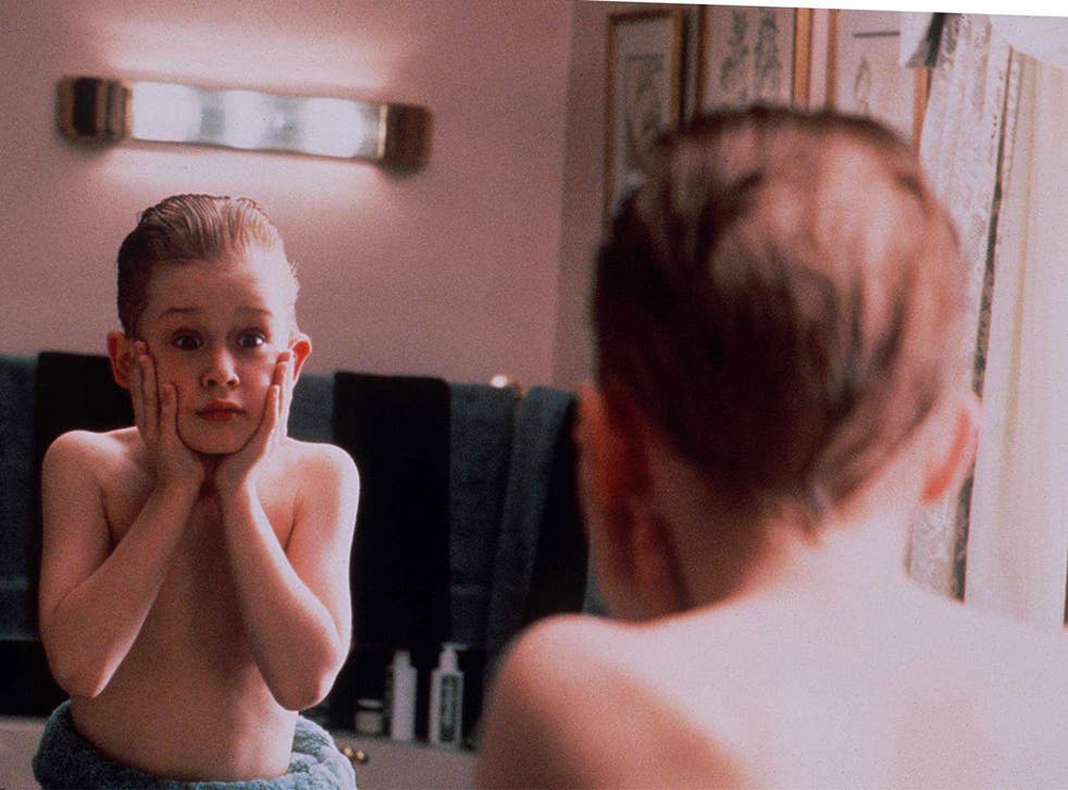 Macaulay Culkin as an 8-year old left behind during a family holiday in Home Alone