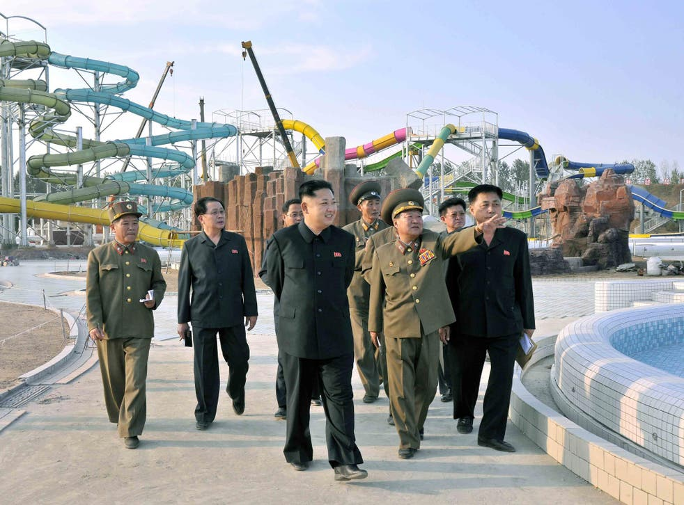 North Korean leader Kim Jong-il (centre) touring the construction site of the Munsu Swimming Complex in Pyongyang, North Korea back in September