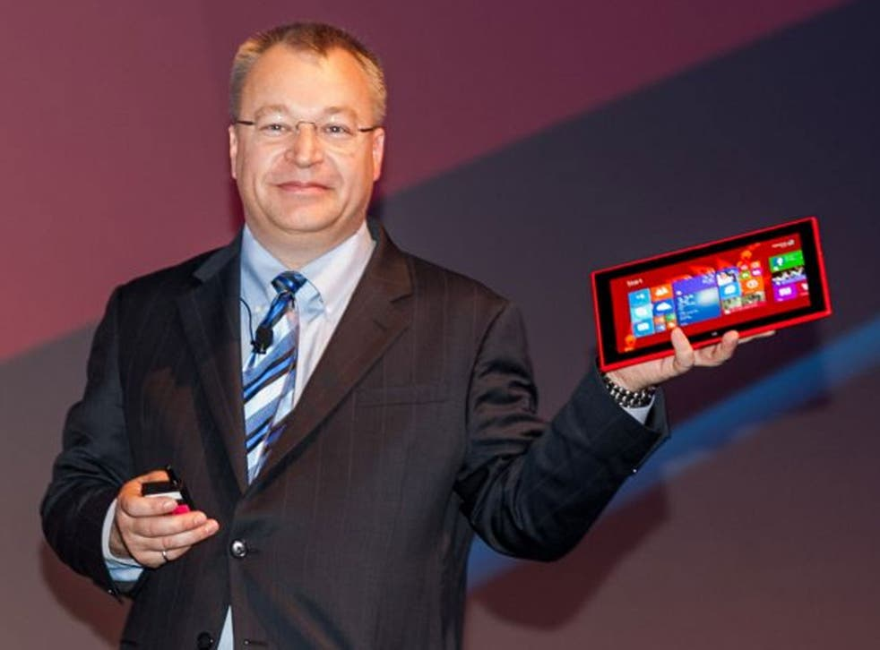 Nokia CEO Stephen Elop holds the $499 Lumia 2520 at Nokia World.