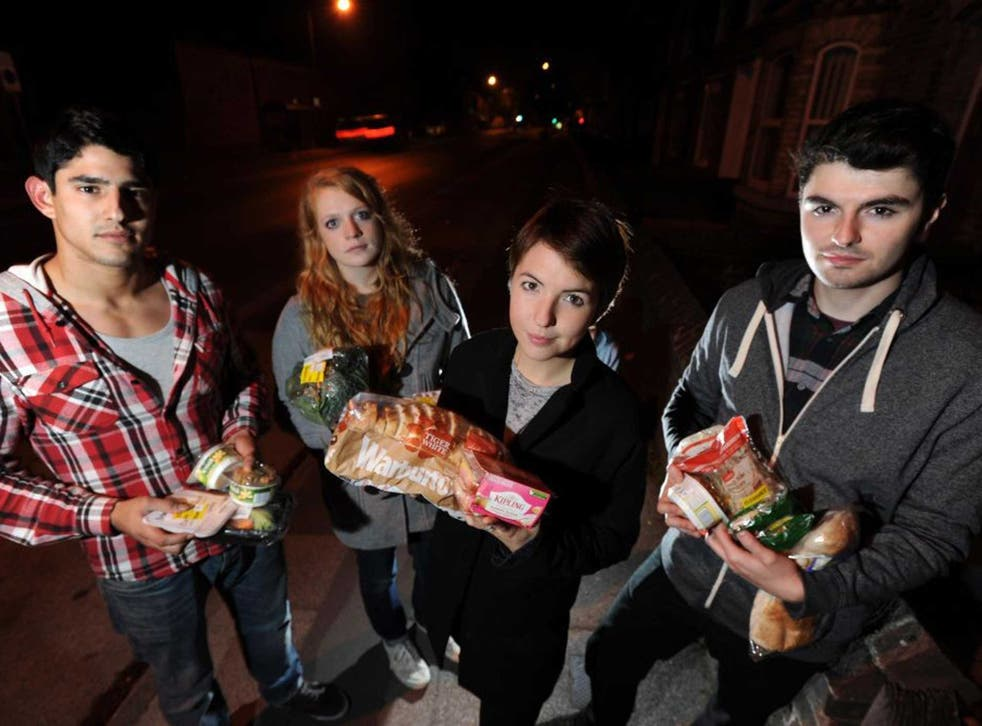 Bin raiding team with food items retrieved from  supermarket bins in York - left to right: Santiago Parilli, Ursula Wild, Jo Barrow, Robin Lee