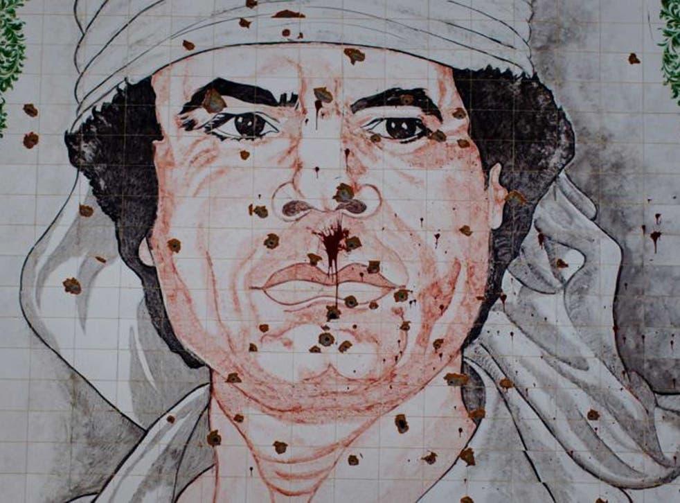 Scars of war: A bullet-riddled Gaddafi mosaic in Tripoli