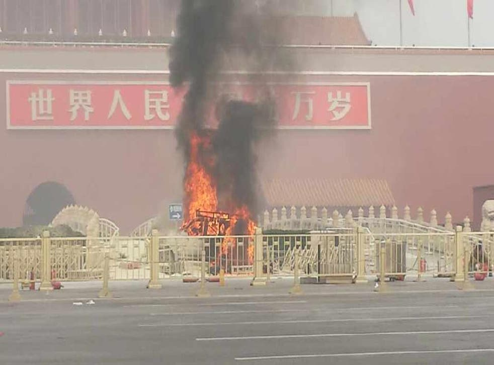 A vehicle burns in Tiananmen Square, China