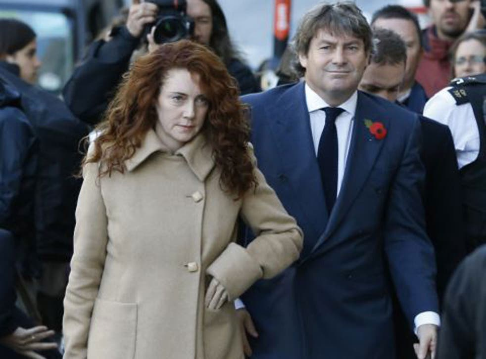 Rebekah Brooks and her husband, Charlie, arrive at the court in London