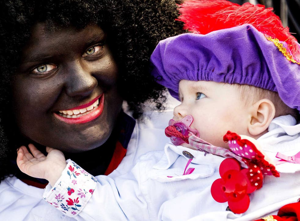 A woman dressed up as Zwarte Piet at the protest in The Hague on Saturday