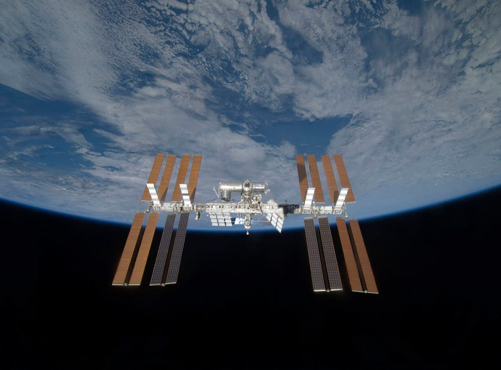 The International Space Station is seen from space shuttle Discovery in 2009.