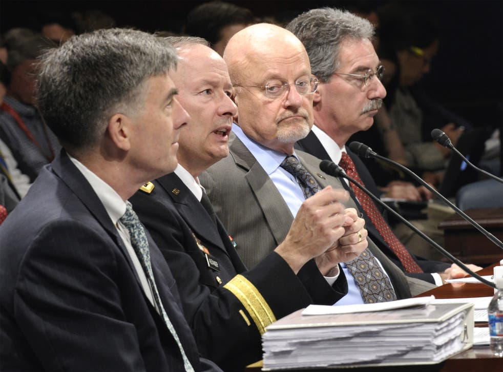 From left: National Security Agency Deputy Director Chris Inglis, National Security Agency Director Gen. Keith Alexander, Director of National Intelligence James Clapper and Deputy Attorney General James Cole, testify on Capitol Hill in Washington before