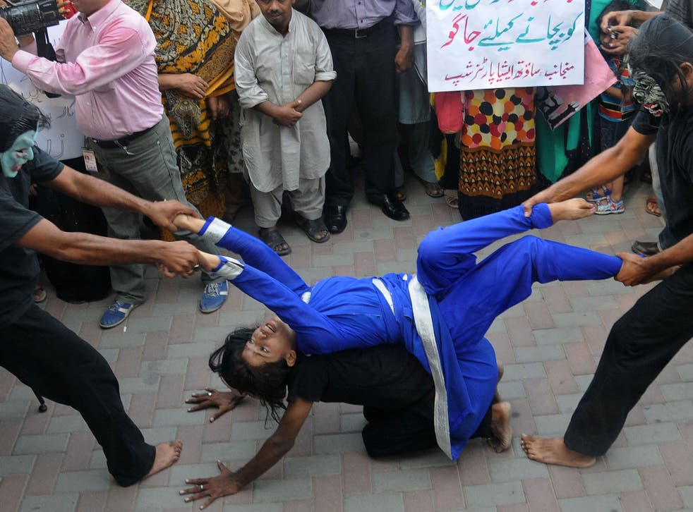 Pakistani workers from NGOs perform during an anti-rape protest in Lahore on 14 September