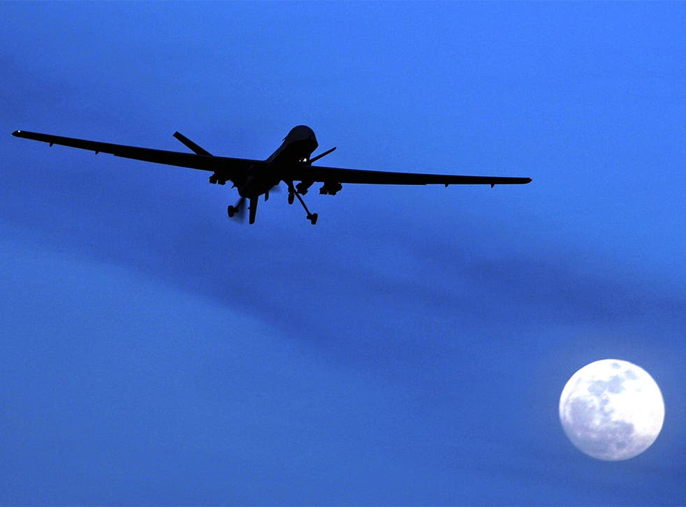 A US Predator drone flies over Kandahar Air Field, southern Afghanistan
